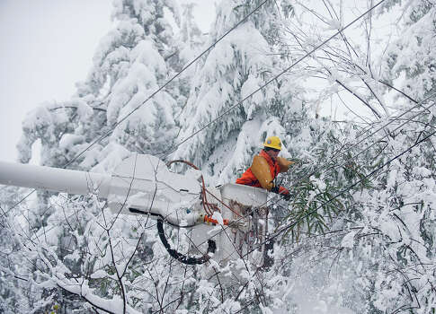 TERRA ALTA, WV - OCTOBER 31: Rob Kohler, an electrical line worker from Kokomo, Indiana, clears snow-laden power lines on October 31, 2012 in Terra Alta, West Virginia.  Hurricane Sandy mixed with colder temperatures in higher elevations and dumped as much as three feet of snow in some places. Photo: Jeff Swensen, Getty Images / 2012 Getty Images