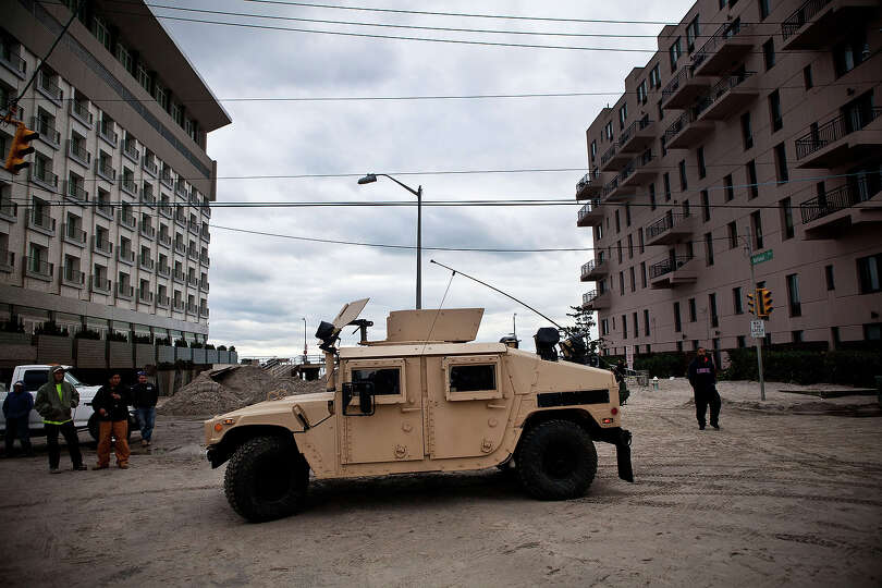 LONG BEACH, NY - OCTOBER 31:  A humvee sits in the middle of  a road after heavy flooding and dune e