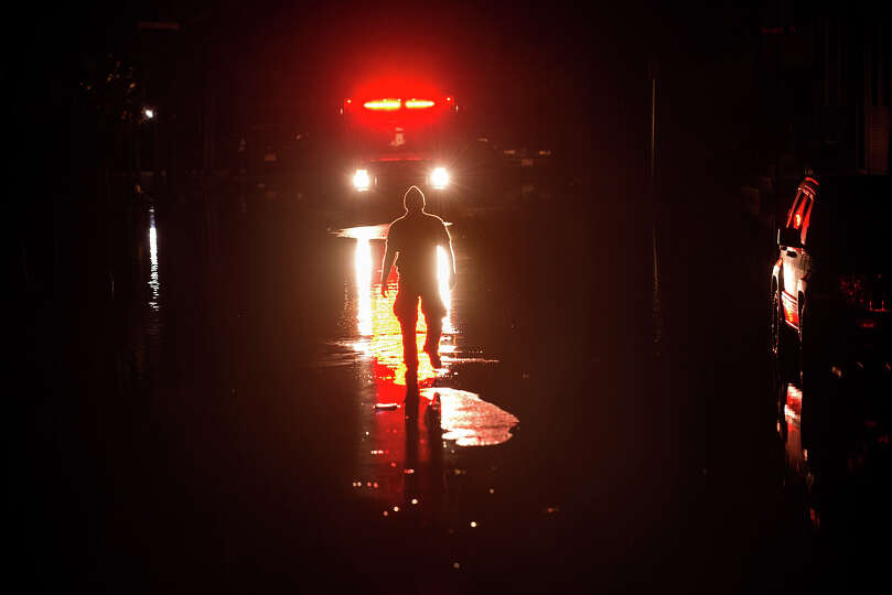 An ambulance is guided down a flooded street October 31, 2012 in Hoboken, New Jersey.  Hurricane San