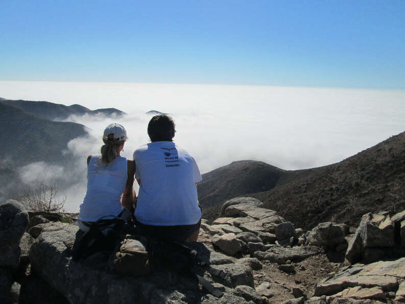 Tami and Phil on Rocky Ridge summit above sea of fog (Tom Stienstra/The Chronicle)