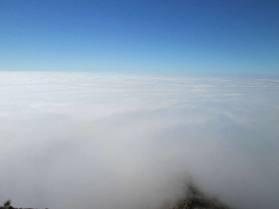 A pearlescent sea, like a giant pool of fog, scanning straight west from the Lookout Bench (Tom Stienstra/The Chronicle)