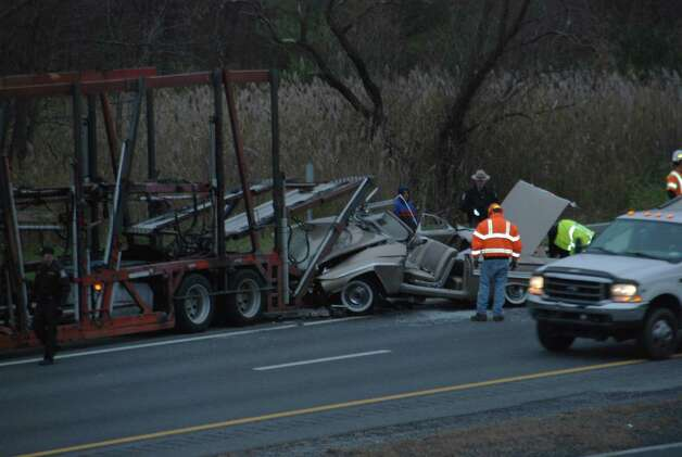 State Police and emergency workers at the scene of a collision on Thursday, Nov. 1, 2012 on the Thruway. At least one person was seriously injured when a car and a tractor trailer crashed just past Exit 22 on the Thruway, State Police said. (Tom Heffernan/Special to the Times Union )