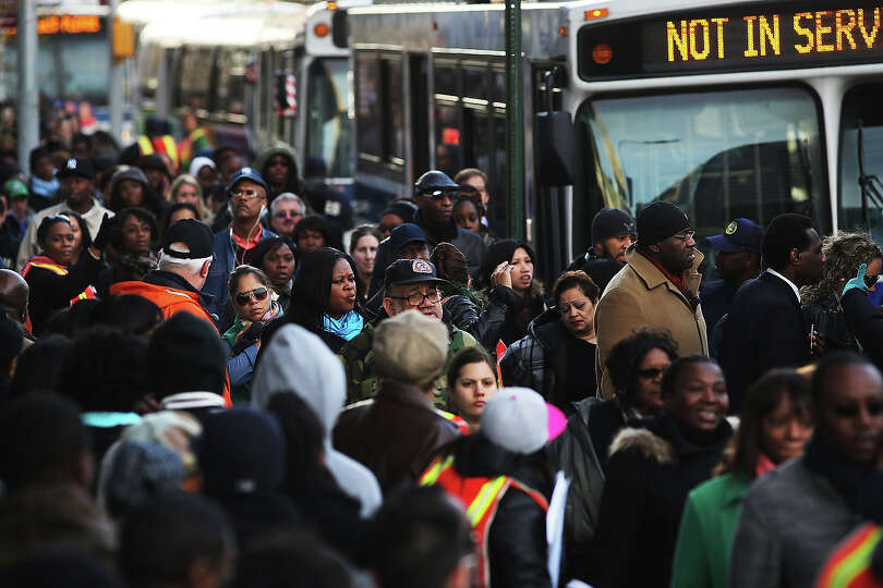NEW YORK, NY - NOVEMBER 01:  Thousands of people wait to board city buses into Manhattan at the newl