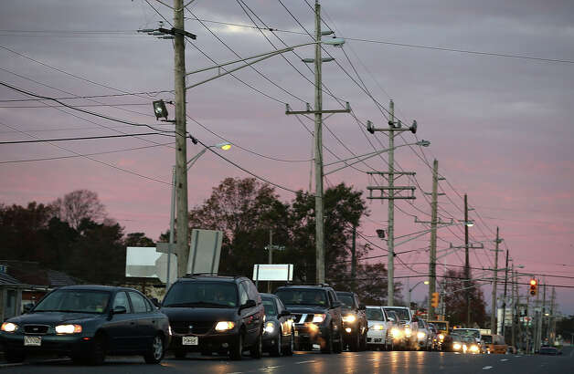 TOMS RIVER, NJ - NOVEMBER 01: Cars wait in line to fuel up at a gas station, on November 1, 2012 in Toms River, New Jersey. With the death toll continuing to rise and millions of homes and businesses without power, the US east coast is attempting to recover from the affects of floods, fires and power outages brought on by superstorm Sandy. Photo: Mark Wilson, Getty Images / 2012 Getty Images