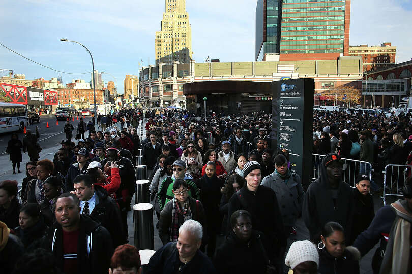 NEW YORK, NY - NOVEMBER 01: Thousands of people wait to board city buses into Manhattan at the newly