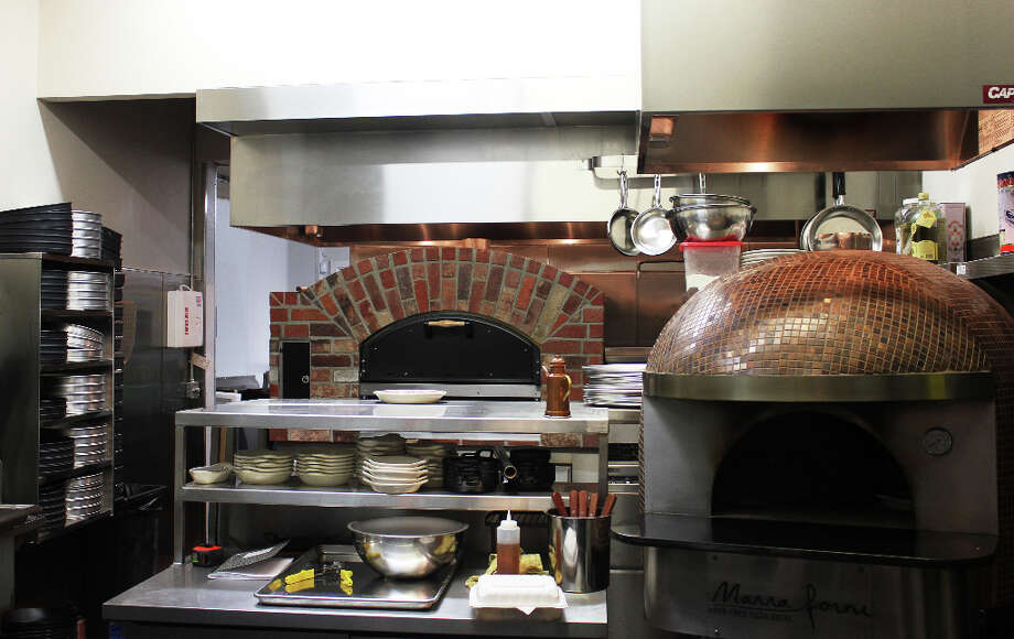 The kitchen. The Neapolitian oven on the right won't be used for pizza (except the Quattro Forni), only for other dishes.