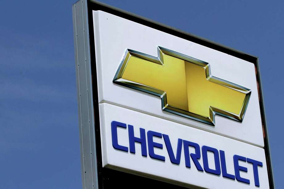 This  July 8, 2012 , photo shows the Chevrolet logo at an auto dealership in Springfield, Ill. A turnaround in South America and a rosier outlook in Europe helped push General Motors shares up Wednesday, July 31, 2012, even though the company's third-quarter net profit fell 14 percent. GM said it earned $1.48 billion from July through September, down from $1.73 billion a year earlier, as European pretax losses widened and North American profits fell. (AP Photo/Seth Perlman) Photo: Seth Perlman