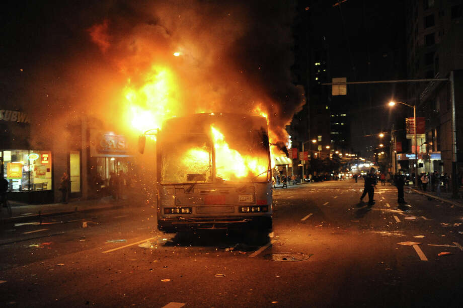 A bus is set on fire on 3rd Street in San Francisco after the Giants won the World Series on October 28, 2012. Photo: Susana Bates, Special To The Chronicle / ONLINE_YES