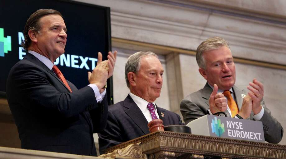 New York City Mayor Michael Bloomberg, center, gives a thumbs up after ringing in the opening bell at the New York Stock Exchange in New York, Wednesday, Oct. 31, 2012. Traffic is snarled, subways out of commission, streets flooded and power out in many parts of the city, but the New York Stock Exchange opened without hitch Wednesday after an historic two-day shutdown, courtesy of Superstrom Sandy. (AP Photo/Seth Wenig) Photo: Seth Wenig