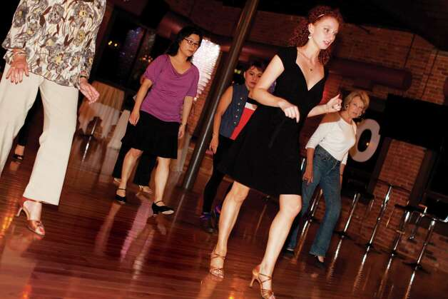 Instructor Meredith Landphair leads a beginner ballroom class at Dance with Me in Stamford. Photo: Wendy Carlson / Healthy Life