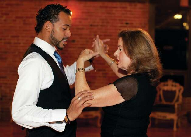 At Dance with Me in Stamford, beginners can learn how to ballroom dance and the more experienced partake in evening dance parties. Here, instructor Edwardo Rojas works with student Lisa Silver. Photo: Wendy Carlson / Healthy Life