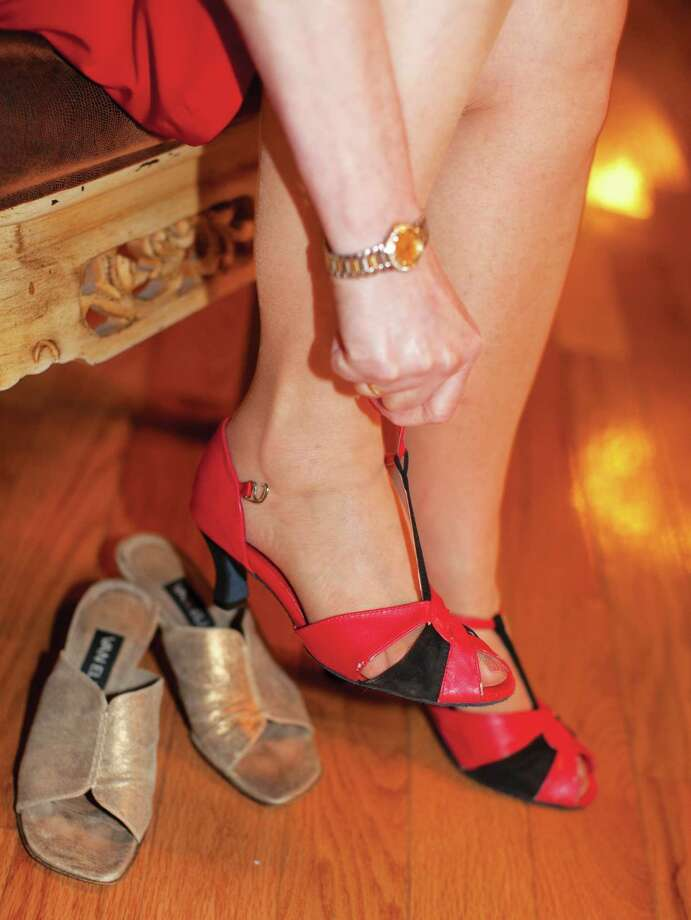 Strapping on dancing shoes at Dance With Me in Stamford. Photo: Wendy Carlson / Healthy Life