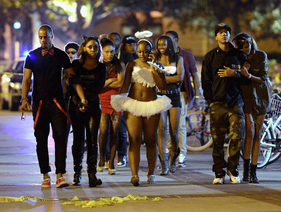 Students and people who attended a party on the campus of USC are allowed to leave after the USC campus was in lockdown after four people were shot including one in critical condition during a Halloween party at the Tutor Campus Center. Photo: Kevork Djansezian, Getty / 2012 Getty Images
