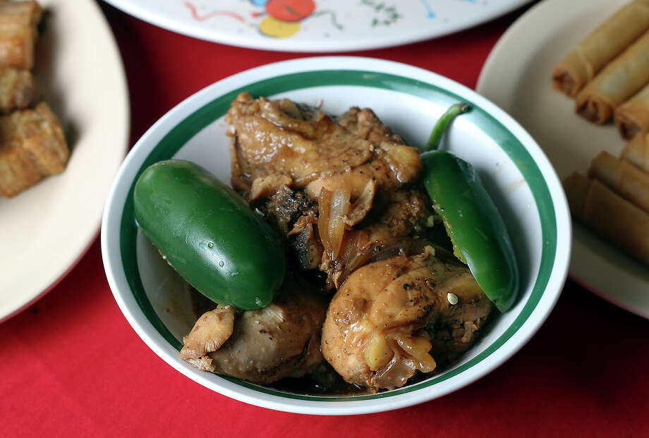 The adobo chicken from Lily's Philippine Restaurant & Bakery on Wednesday, Oct. 31, 2012. Photo: Kin Man Hui, San Antonio Express-News / San Antonio Express-News