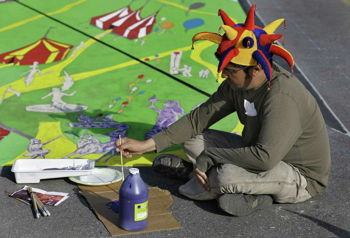 Anthony Cappetto, of New York, NY., works on his pavement art project during the Sarasota Chalk Festival Wednesday, Oct. 31, 2012, in Sarasota, Fla. The annual festival begins this week and runs through Nov. 6.
