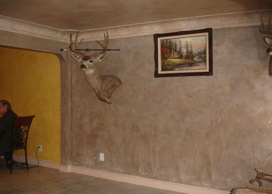 Not only dead, this deer head seems to grow out of the wall. Photo via Hooked On Houses.Net.  (http://hookedonhouses.net/2011/08/23/this-week-in-bad-mls-photos-animals-in-the-house/)