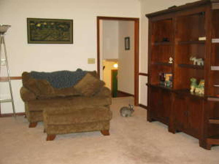 Note the bunny in the doorway. One hopes, for rabbit's sake, that this is not the same home as the deer head. Photo via Hooked On Houses.Net.  (http://hookedonhouses.net/2011/08/23/this-week-in-bad-mls-photos-animals-in-the-house/)
