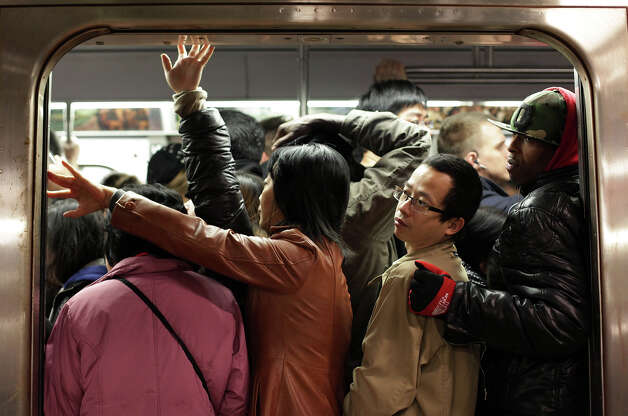 NEW YORK, NY - NOVEMBER 1: Commuters ride the F train November 1, 2012 in New York City. Limited public transit has returned to New York. With the death toll continuing to rise and millions of homes and businesses without power, the U.S. east coast is attempting to recover from the effects of floods, fires and power outages brought on by Superstorm Sandy. Photo: Allison Joyce, Getty Images / 2012 Getty Images