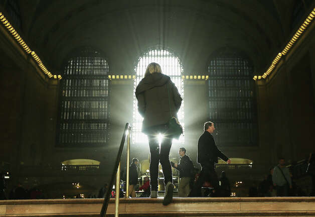 NEW YORK, NY - NOVEMBER 01:  People walk through Grand Central Terminal as the sun rises during a subdued morning rush on November 1, 2012 in New York City. Some trains are back up and running into Grand Central following shutdowns in the aftermath of Superstorm Sandy.  Subway train service in the city is back in a limited capacity, but with much of lower Manhattan still with out power, trains are not running there and busses are replacing them. Photo: Mario Tama, Getty Images / 2012 Getty Images