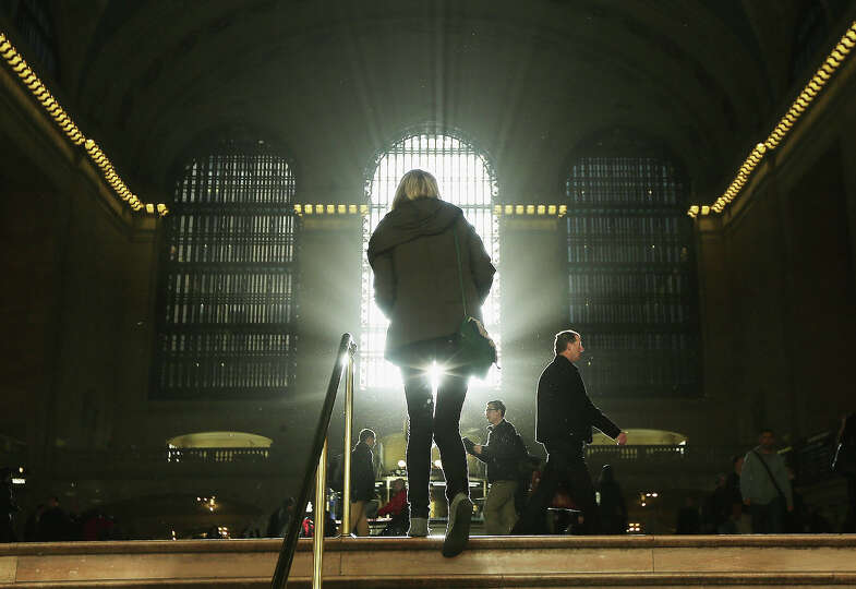 NEW YORK, NY - NOVEMBER 01:  People walk through Grand Central Terminal as the sun rises during a su
