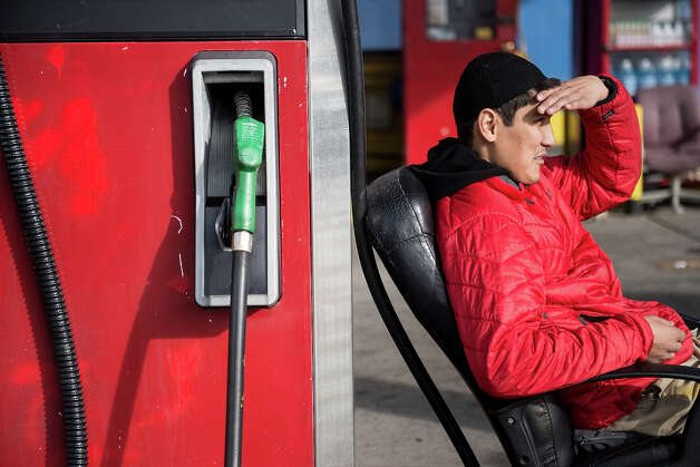 Zafar Ismail watches over a closed gas station he works at on November 1, 2012 in Hoboken, New Jersey.  Hurricane Sandy, which made landfall along the New Jersey shore, has left the state with a fuel shortage due to logistical problems and power failures. AFP PHOTO/Brendan SMIALOWSKI Photo: BRENDAN SMIALOWSKI, AFP/Getty Images / 2012 AFP