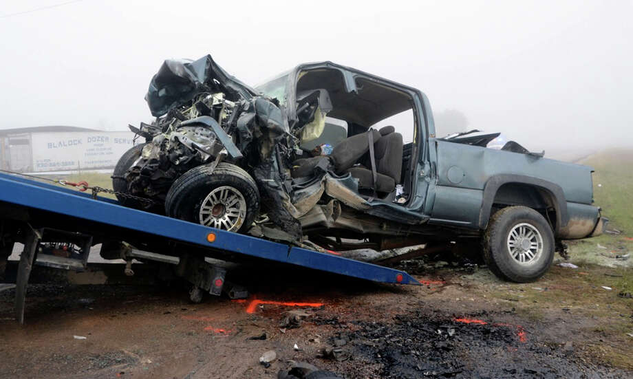 A demolished truck is removed from a crash scene where two people died and four others injured this morning when two pickups collided head-on in Atascosa County. Another vehicle also was involved in the accident. The crash happened on Texas 16 near Jourdanton. Photo: Jack Garcia, For The Express-News / Jack Garcia/ For the San Antonio