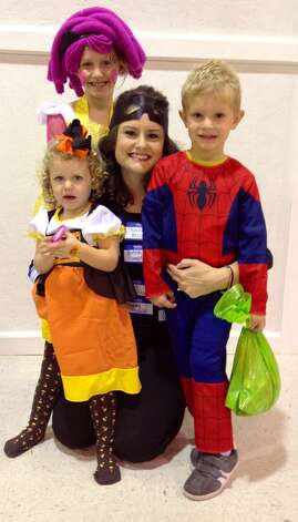 The Moores transformed into Lala Loopsy, identity thief, candy corn and Spider-Man.  Photo by Amy Moore/The Enterprise.