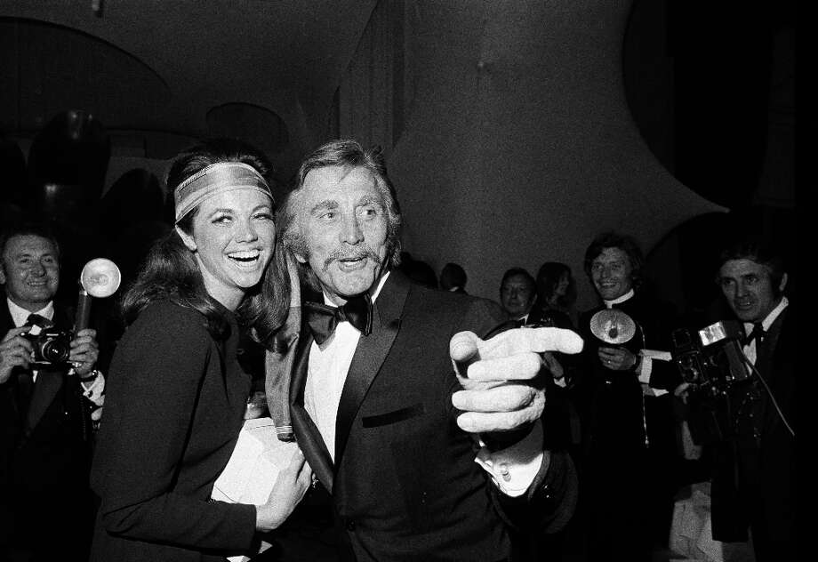 "Kirk Douglas shows off the ""chevron.""AMI definition: ""A thick and wide mustache, usually worn long to cover the top border of the upper lip."" Photo: Anonymous, AP / 1970 AP"