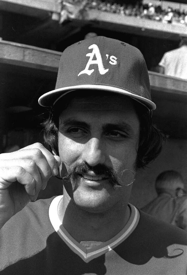 "Rollie Fingers is a preeminent example of a man wearing a handlebar mustacheAMI definition: ""A handle bar mustache can be worn large or small (""petit handlebar""); it is characterized by the fact that it is bushy and must be worn long enough to curl the ends upward, which is usually achieved with styling wax."" Photo: RH, ASSOCIATED PRESS / AP1973"