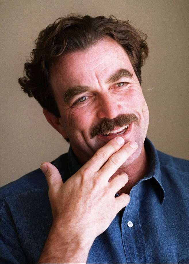 """One of America's most famous mustached men, Tom Selleck, has long worn a painter's brush mustache.AMI definition: """"A thick mustache covering the width of the mouth, usually worn short, with slightly rounded corners."""" Photo: CHRIS PIZZELLO, ST / AP"""