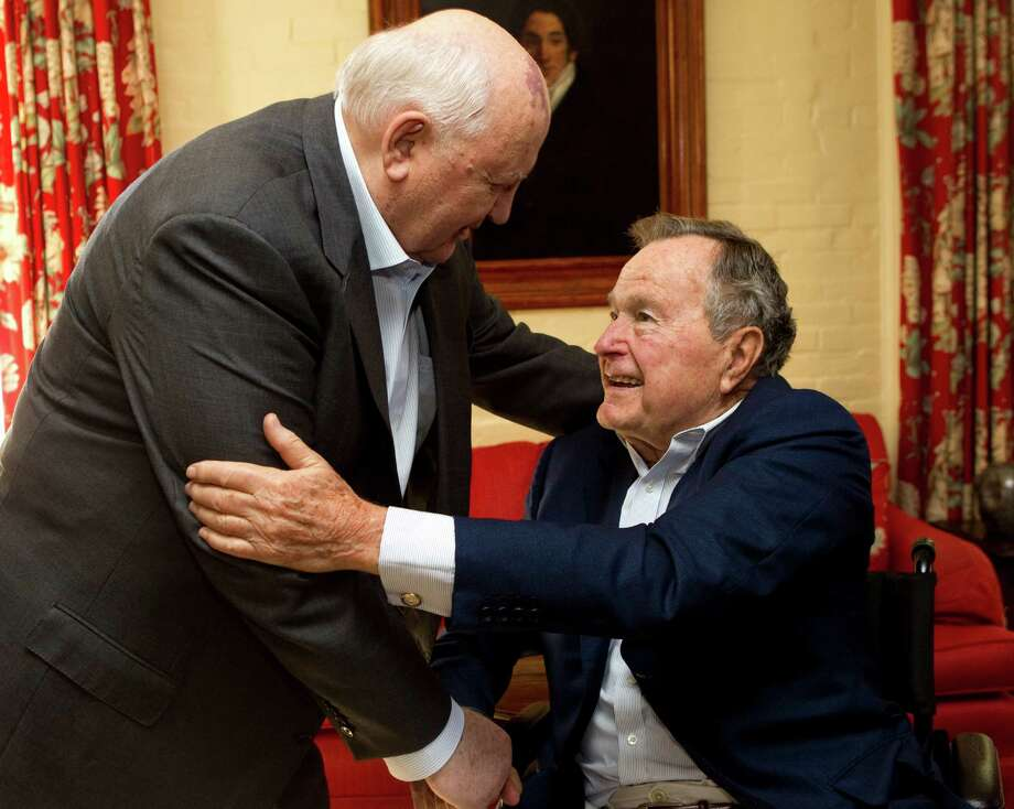 Mikhail Gorbachev, former leader of the Soviet Union, left, greets former President George H.W. Bush before having lunch together Thursday, Nov. 1, 2012, in Houston. Photo: Brett Coomer, Houston Chronicle / Houston Chronicle