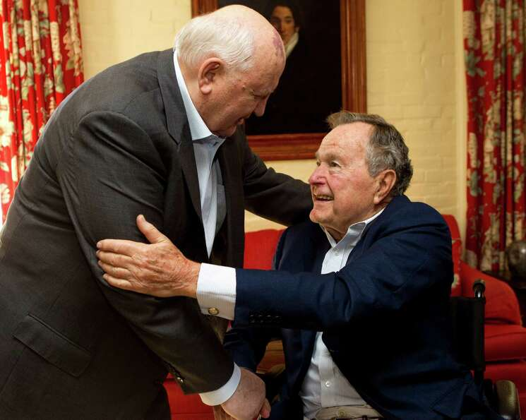 Mikhail Gorbachev, former leader of the Soviet Union, left, greets former President George H.W. Bush