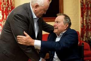 Mikhail Gorbachev, former leader of the Soviet Union, left, greets former President George H.W. Bush before having lunch together Thursday, Nov. 1, 2012, in Houston.