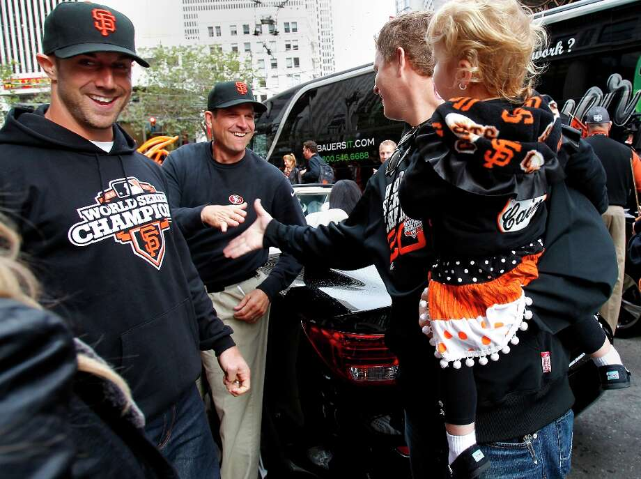 Matt Cain got a handshake from 49ers coach Jim Harbaugh as Alex Smith (left) looked on. The San Francisco Giants celebrated their second World Series title in three years with a parade down Market Street Wednesday October 31, 2012. Photo: Brant Ward, The Chronicle / ONLINE_YES