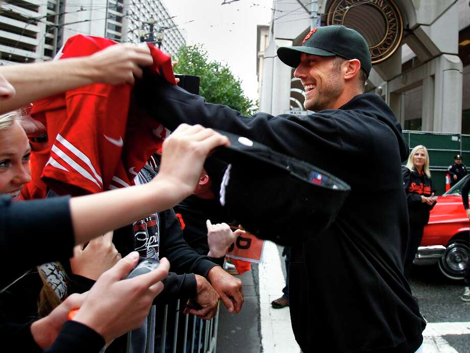 49ers quarterback Alex Smith greeted Giants fans. The San Francisco Giants celebrated their second World Series title in three years with a parade down Market Street Wednesday October 31, 2012. Photo: Brant Ward, The Chronicle / ONLINE_YES