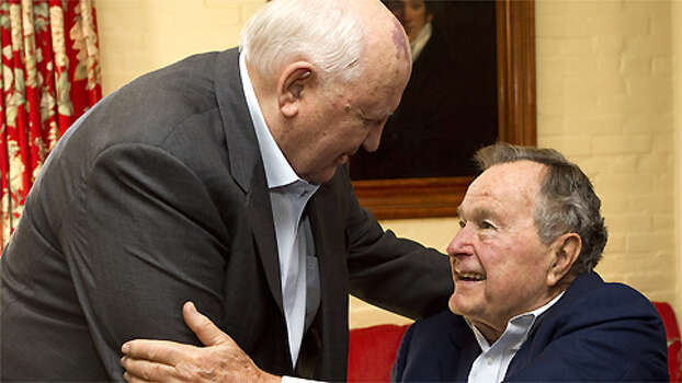 Mikhail Gorbachev, former leader of the Soviet Union, greets former President George H.W. Bush before having lunch together in Houston on Nov. 1, 2012. ( Brett Coomer / Houston Chronicle ) Photo: Brett Coomer, Bushgorby / © 2012 Houston Chronicle