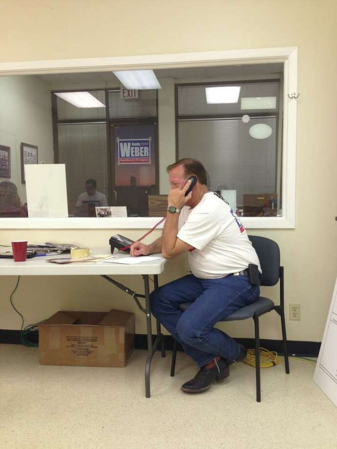 Randy Weber makes phone calls to remind voters about early voting before the final presidential debate. ((Randy Weber Facebook Page))