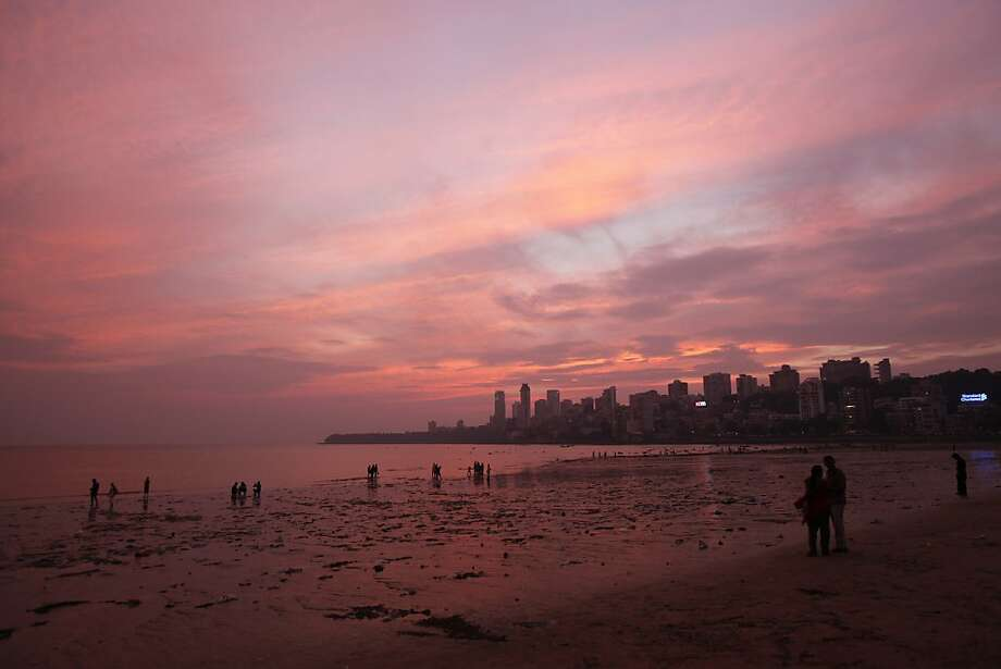 A sunset turns a seascape pink at a beach in Mumbai. Photo: Rajesh Kumar Singh, Associated Press