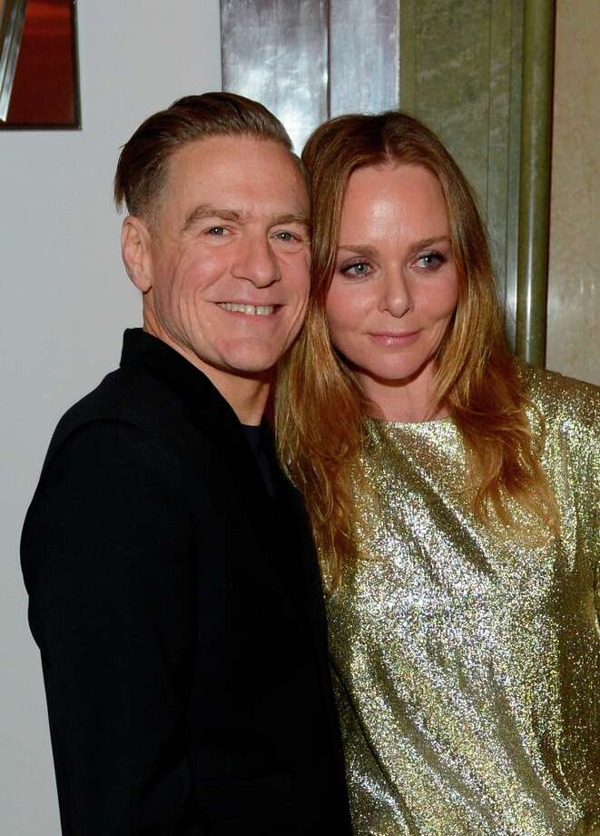 Bryan Adams, left, and Stella McCartney are seen at the Harper's Bazaar Woman of the Year Awards 2012 in association with Estée Lauder, Harrods and Tiffany & Co. at Claridge's Hotel on Wednesday, Oct. 31, 2012 in London. Photo: Jon Furniss, Jon Furniss/Invision/AP / Invision2012