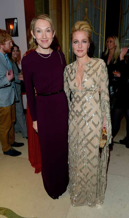 Justine Picardie, left, and Gillian Anderson are seen at the Harper's Bazaar Woman of the Year Awards 2012 in association with Estée Lauder, Harrods and Tiffany & Co. at Claridge's Hotel on Wednesday, Oct. 31, 2012 in London. Photo: Jon Furniss, Associated Press / Invision