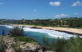 The four-mile Mahaulepu Trail starts at the southern end of Keoniloa, nicknamed Shipwreck Beach, which has a public access parking lot next to the Grand Hyatt Kauai. After a short walk uphill through ironwood trees, the trail mostly levels out, with gentle rises and falls after that.