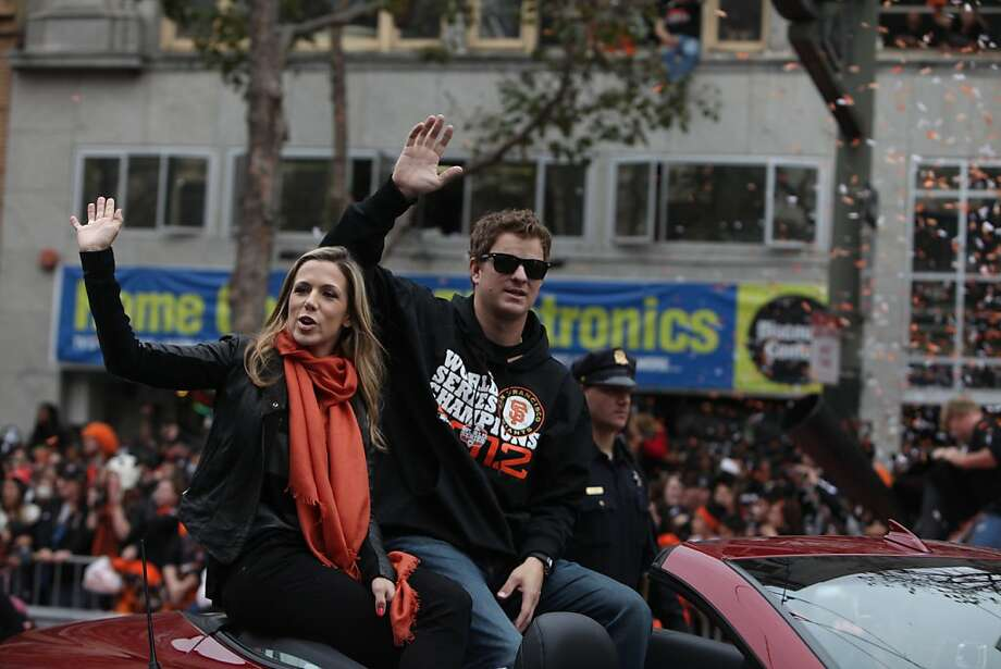 San Francisco Giants pitcher Matt Cain (right) and his wife Chelsea (left) wave to fans gathered along the parade route during the San Francisco Giants World Series victory parade on Wednesday, October 31, 2012 in San Francisco, Calif. Photo: Lea Suzuki, The Chronicle