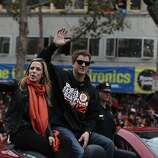 San Francisco Giants pitcher Matt Cain (right) and his wife Chelsea (left) wave to fans gathered along the parade route during the San Francisco Giants World Series victory parade on Wednesday, October 31, 2012 in San Francisco, Calif.