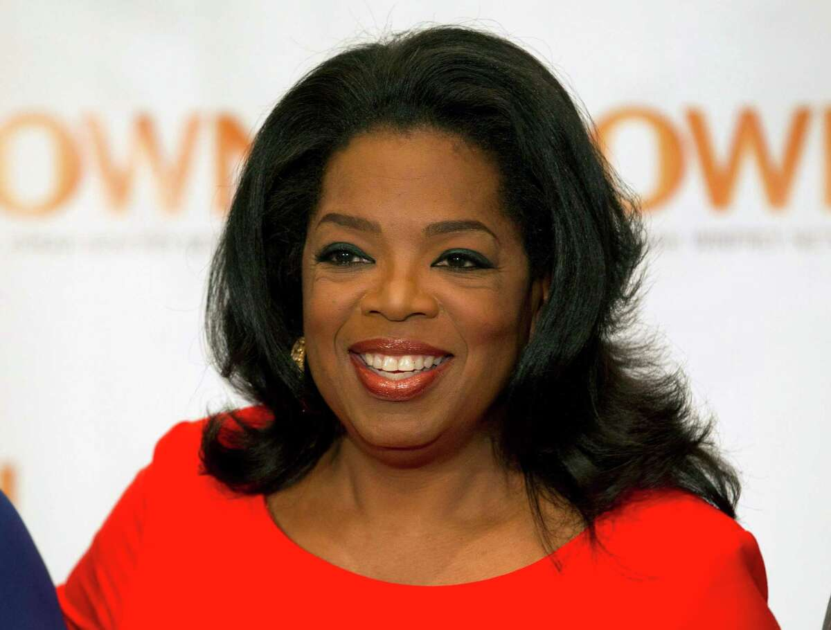 FILE - This April 16, 2012 file photo shows Oprah Winfrey in Toronto. Winfrey and Arianna Huffington launched