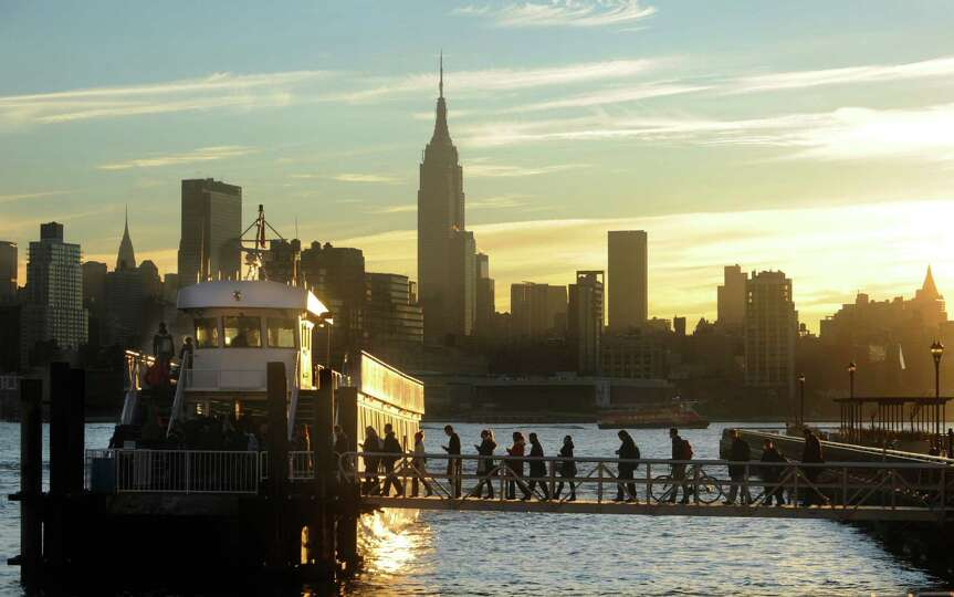 Commuters board a New York Waterway ferry bound for Midtown Manhattan at the 14th Street pier Thursd