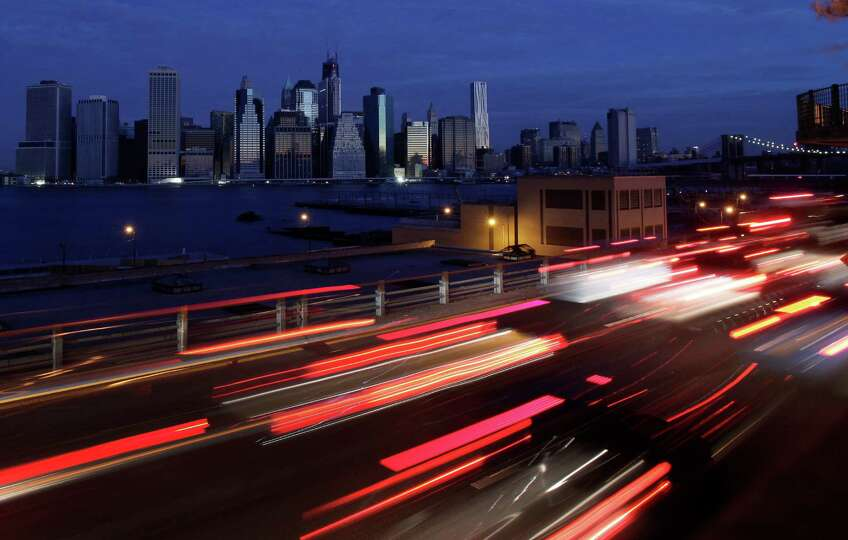 Early morning traffic in Brooklyn moves slowly beneath the Manhattan skyline, Thursday, Nov. 1, 2012