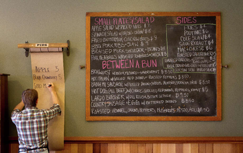 Beth Boylan writes the pie specials for the day. Photo: John Storey, Special To The Chronicle / ONLINE_Yes