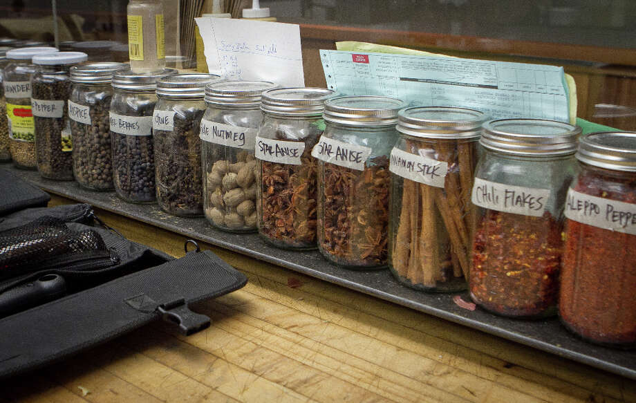Spices in the kitchen at Pig and Pie. Photo: John Storey, Special To The Chronicle / ONLINE_Yes