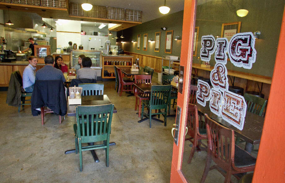 People have lunch at Pig and Pie. Photo: John Storey, Special To The Chronicle / ONLINE_Yes