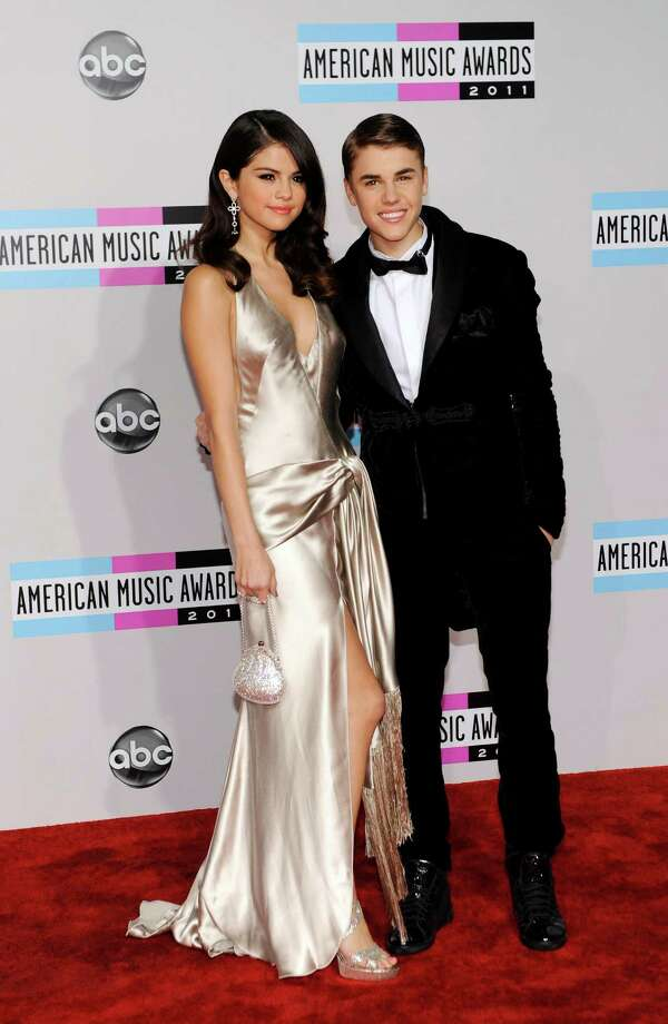 Selena Gomez, left, and Justin Bieber arrive at the 39th Annual American Music Awards on Sunday, Nov. 20, 2011 in Los Angeles. (AP Photo/Chris Pizzello) Photo: Chris Pizzello, Associated Press / AP
